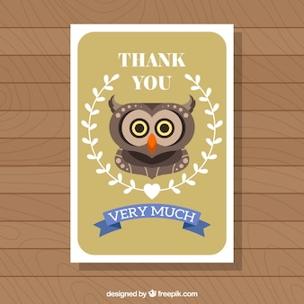 Greeting card template with owl and floral wreath