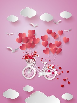Greeting card with bike and air balloons in heart shape.