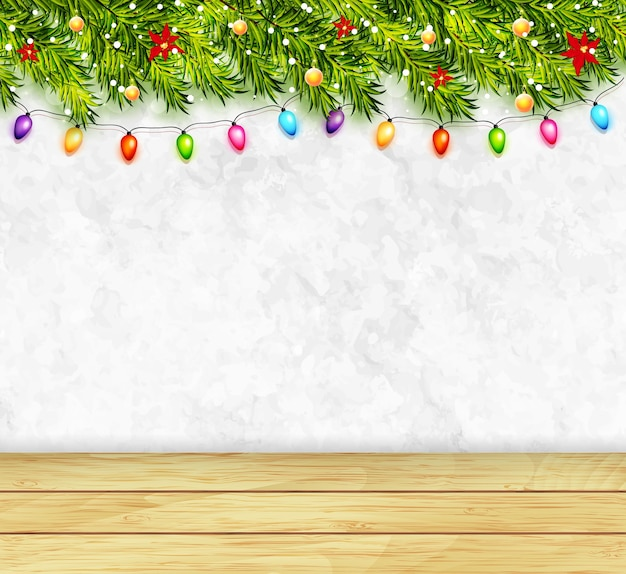 Greeting card with christmas tree branches, garlands and wood table top. merry christmas and happy new year greeting background