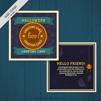 Greeting card with ghosts and spiders for halloween Free Vector