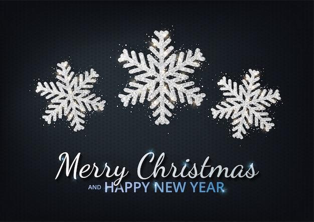 明けましておめでとうございますとクリスマスのグリーティングカード。メタリックシルバーのクリスマススノーフレーク