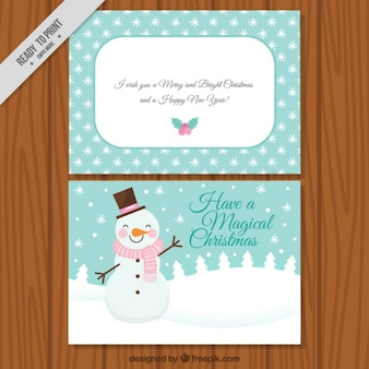 Greeting card with smiling snowman and decorative snowflakes