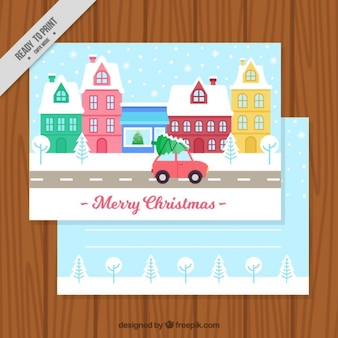 Greeting card with snowy town and car for christmas