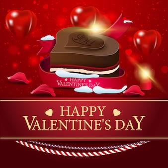 チョコレート菓子とバレンタインデーのグリーティングカード赤