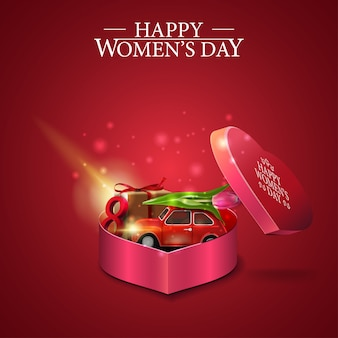 Поздравительная красная открытка на женский день с подарком в форме сердца