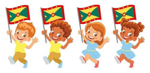 Флаг гренады в руке. дети держат флаг. государственный флаг гренады