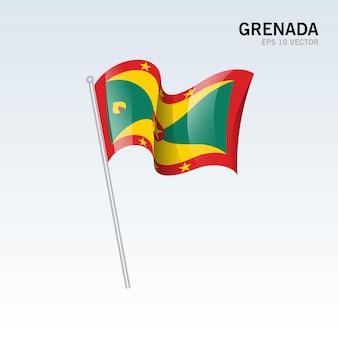 グレーに分離された旗を振っているグレナダ