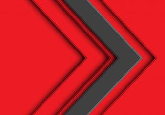 赤の背景に灰色の矢印の方向。