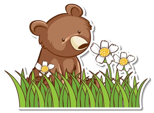 Медведь гризли сидит в траве поля наклейка