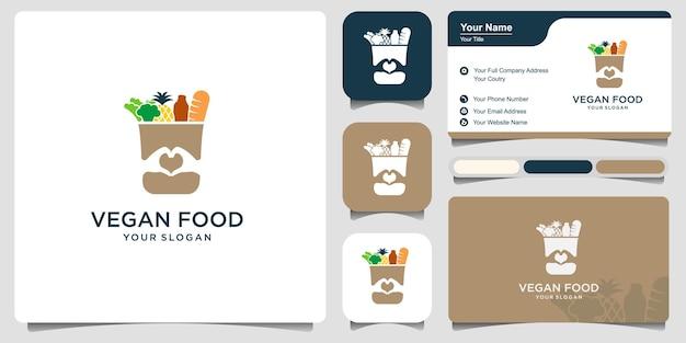 食品のロゴデザインと名刺が付いた食料品の紙袋。健康的なビーガンビーガンフードベクターデザインの再利用可能な製品バッグ。