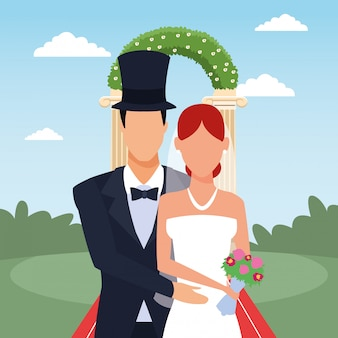 Groom and bride standing over floral arch and landscape
