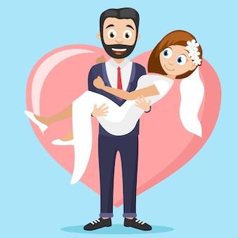 新郎は大きな心を背景に腕に花嫁を抱えています。