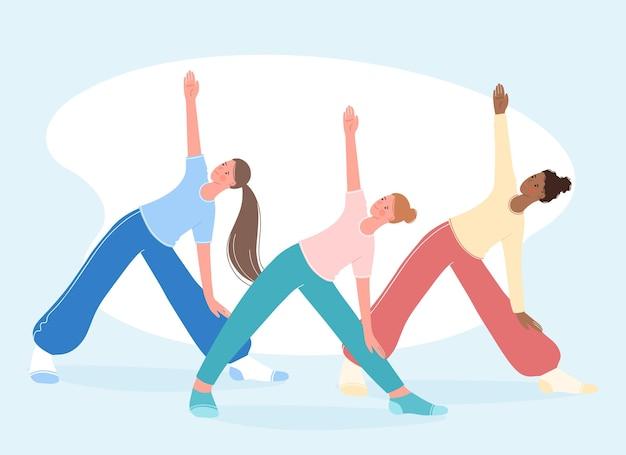 Group aerobics fitness and yoga classes people stand in triangle pose trikonasana