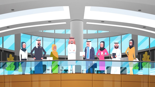 Group of arabic business people in modern office wearing traditional clothes arab businessman and businesswoman employees workers