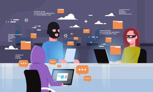 Group black mask sitting at computer