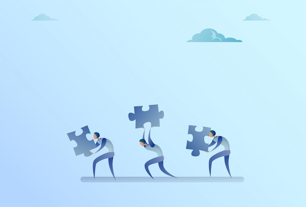 Group of business people carry puzzle parts teamwork cooperation concept
