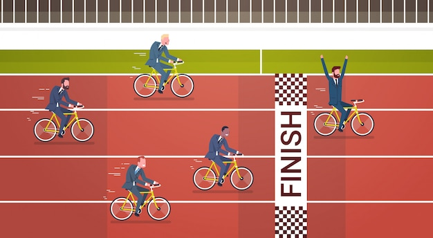 Group of business people ride bicycles to finish line leadership and competition concept