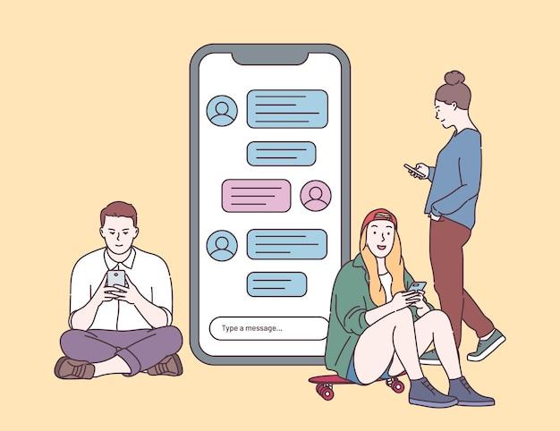 グループチャットチャットメッセージオンラインコミュニケーション電話でタイピングチャットを話している若者フラットベクトルイラスト