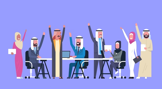 Group of cheerful arabic business people happy hold raised hands muslim workers team success