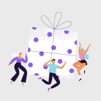 Group of cheerful people jumping around the big gift box.