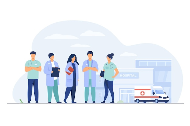 Gruppo di medici in piedi all'edificio dell'ospedale. squadra di praticanti e auto ambulanza