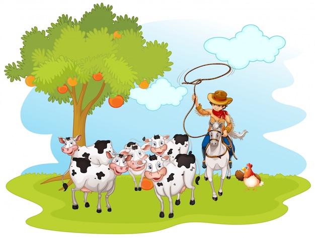 Gruppo di animali domestici con il cowboy in un'azienda agricola isolata