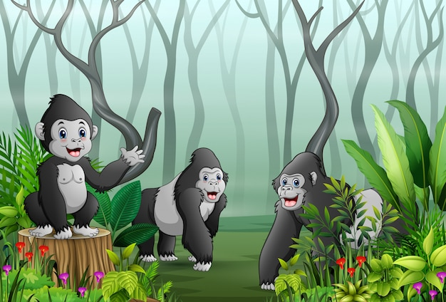 A group of gorillas in a forest with dry tree branches