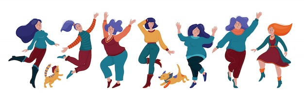 Group of happy dancing women in warm clothes