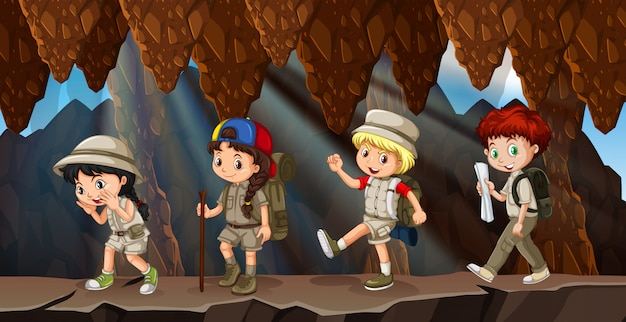 A group of kids hiking in cave