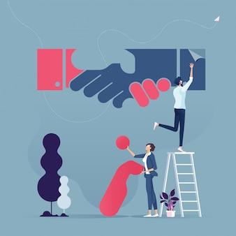 Группа бизнес построить рукопожатие знак из кусочков головоломки