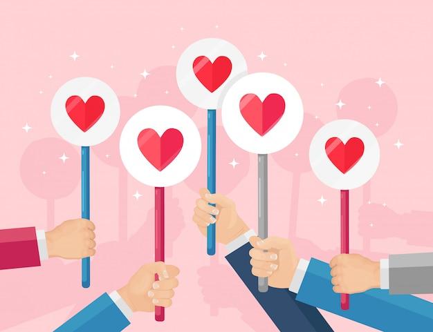 赤いハートのプラカードを持つビジネス人々のグループ。ソーシャルメディア、ネットワーク。良い意見。お客様の声、フィードバック、カスタマーレビュー、コンセプトなど。バレンタイン・デー。フラットデザイン