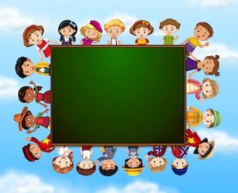 Group of children around chalk board