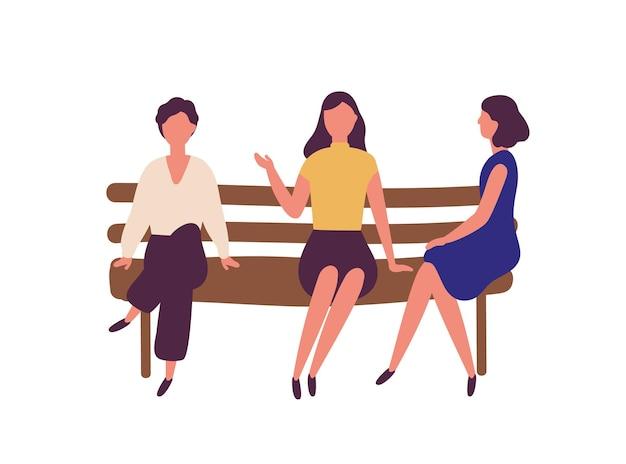 公園のベンチに座って話しているかわいい若い女性のグループ