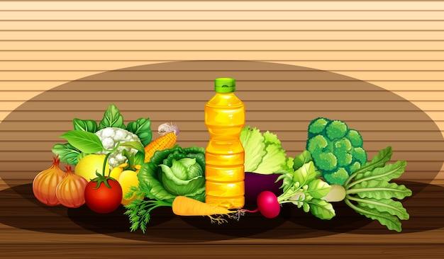 異なる野菜と木製の壁の背景に油のボトルのグループ