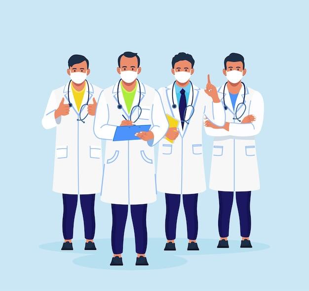 코트와 안면 마스크를 쓴 의사 그룹이 함께 서 있습니다.