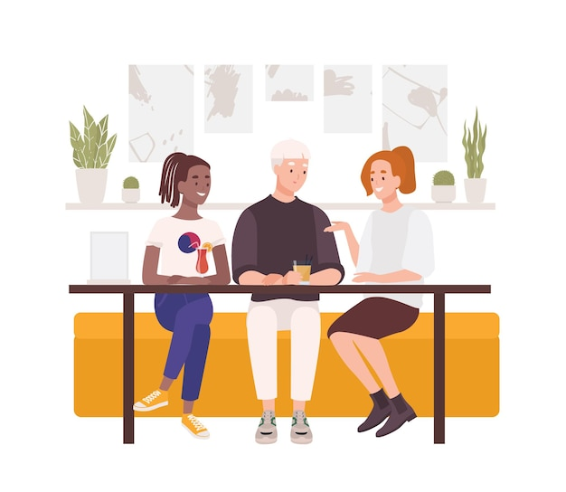 カフェのテーブルに座って、カクテルを飲み、話している友人のグループ