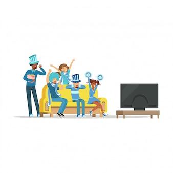 テレビでスポーツを見ていると自宅で勝利を祝っている友人のグループ。好きなスポーツチームのイラストを支える青い服を着た人々