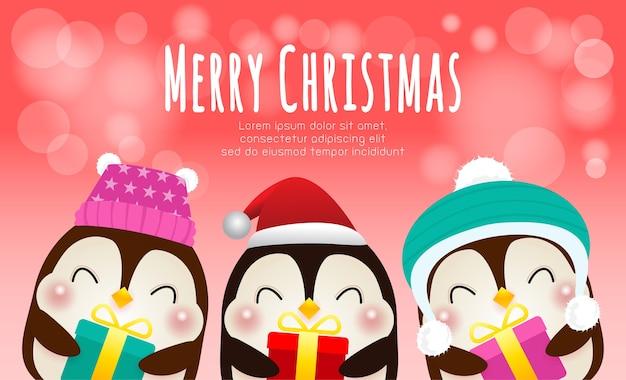 クリスマスの帽子とギフトを身に着けている幸せなペンギンのグループ
