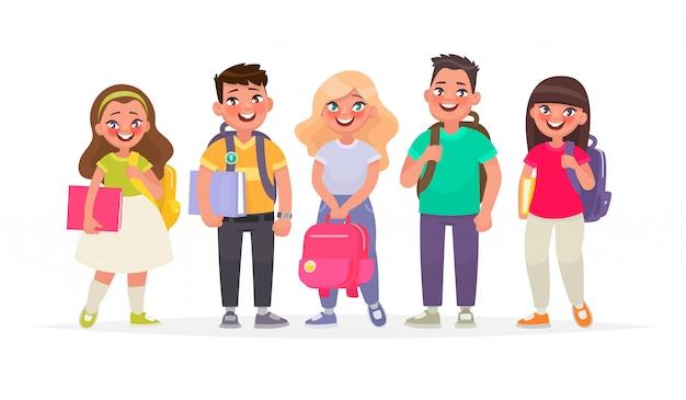 Группа счастливых учеников. юноши и девушки с рюкзаками и книгами. дети начальной школы
