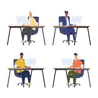 職場のコンピューターのデスクトップで働く男性のグループ