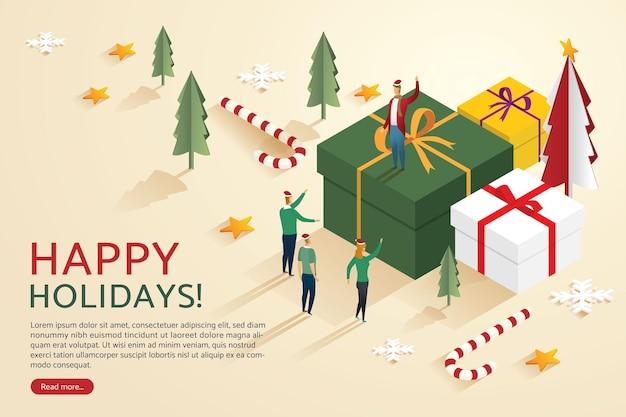 ギフトボックスでクリスマスを祝う人々のグループメリークリスマスと新年あけましておめでとうございます