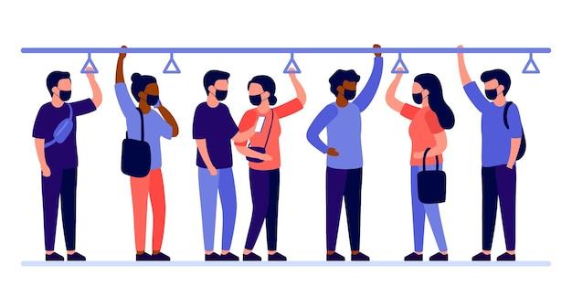 保護フェイスマスクの人々のグループは、輸送地下鉄、バスに立っています。コロナウイルスの期間中、男性と女性は公共交通機関で旅行します。乗客は手すりを握ります。図