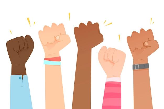 Группа людей поднимает кулаки