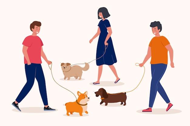 犬を散歩する人々のグループ