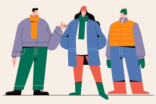 居心地の良い冬服を着ている人々のグループ