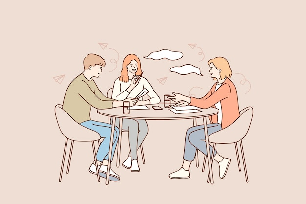 책상에 앉아 긍정적 인 사업 노동자의 그룹