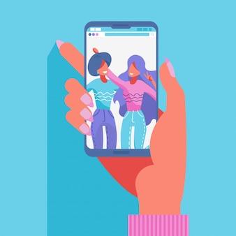 스마트 폰으로 사진을 찍는 두 여자 친구의 그룹