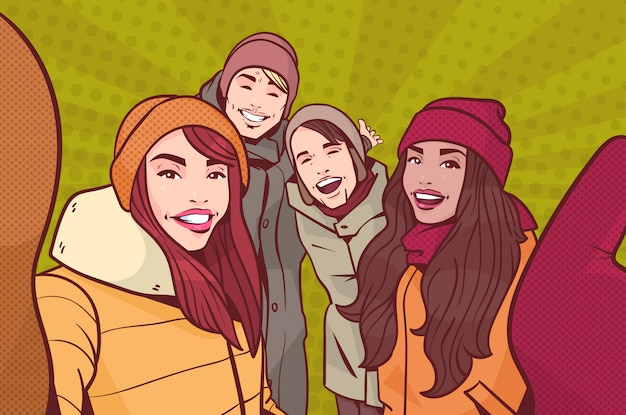 Группа молодых людей, делающих селфи фото, носящих зимнюю одежду на фоне красочных ретро-стилей, смешанных рас, мужчина и женщина, счастливые, улыбающиеся, принимают автопортрет.