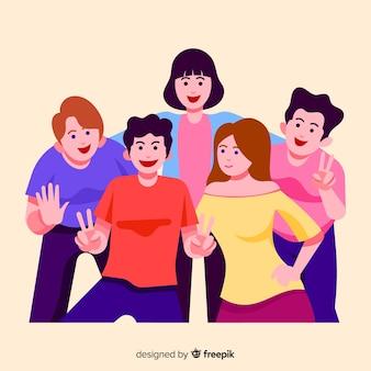 사진을 위해 포즈를 취하는 젊은 사람들의 그룹