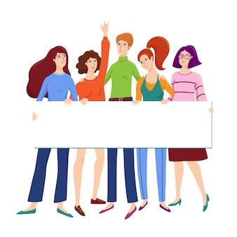 Группа молодых женщин, друзья обнимали друг друга и держат пустой баннер с местом для текста